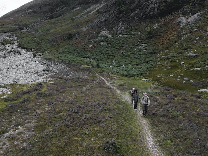 Group of friends trekking in Glen Etive, Scotland