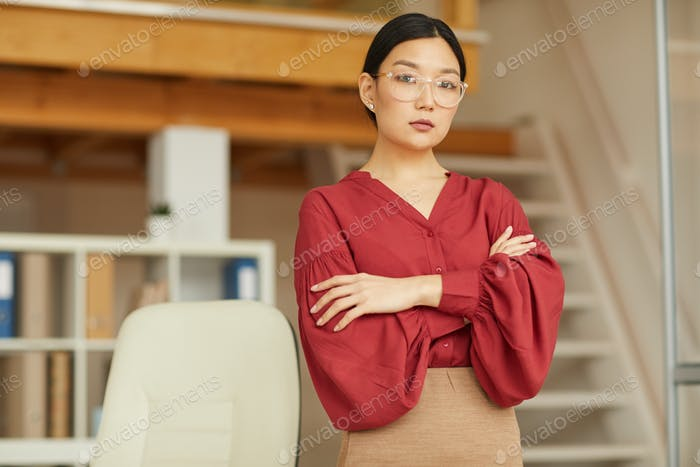 Elegant Asian Businesswoman in Red