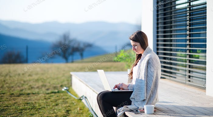 Woman working outdoors at home, Corona virus and quarantine concept