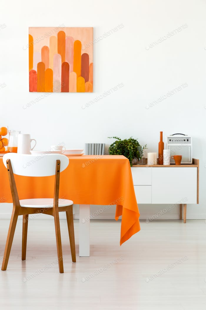 White Wooden Chair At Table With Orange Cloth In Dining Room Int