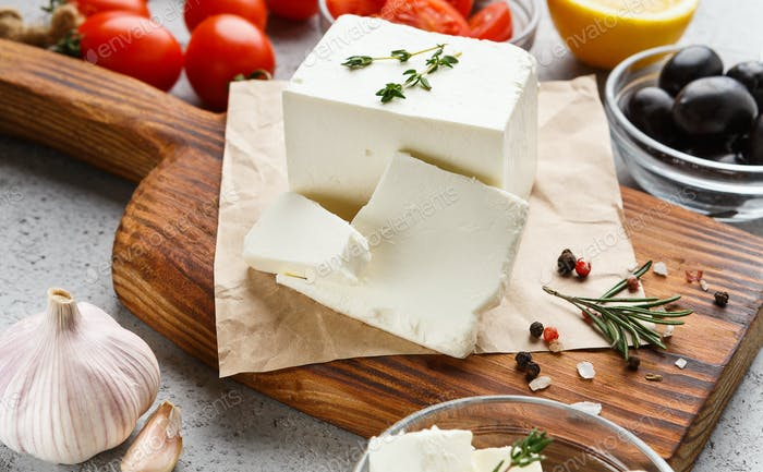 Cubes of feta and spices on board