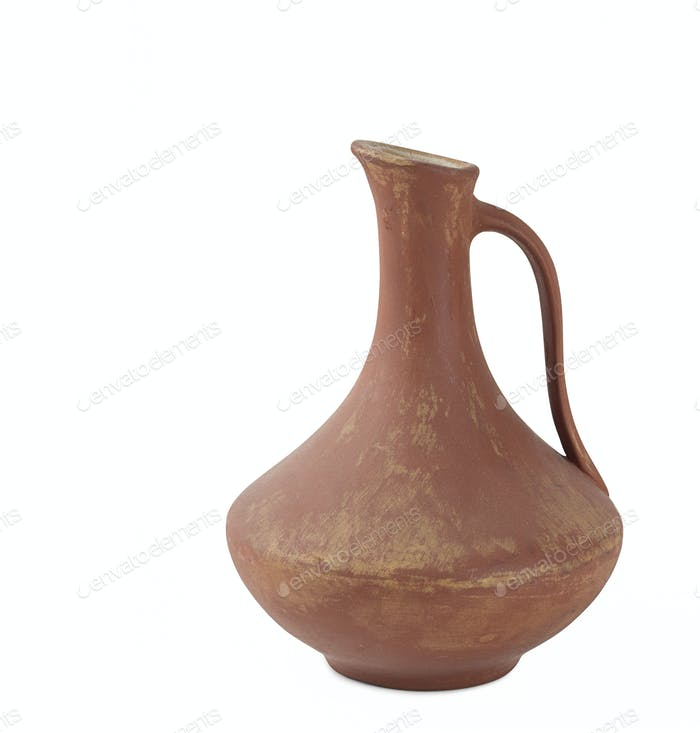 Ancient wine jug isolated on white background.