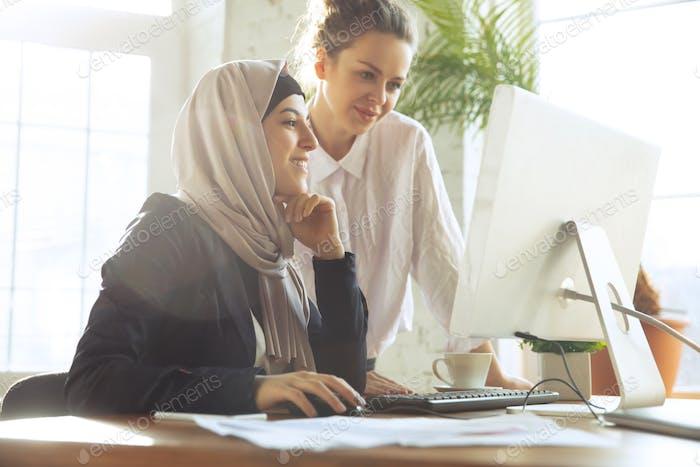 Portrait of a beautiful arabian businesswoman wearing hijab while working