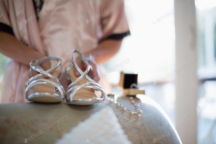 Bride holding pair of sandals