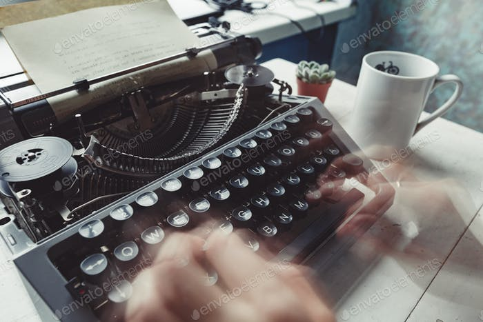 Writer typing with retro writing machine.