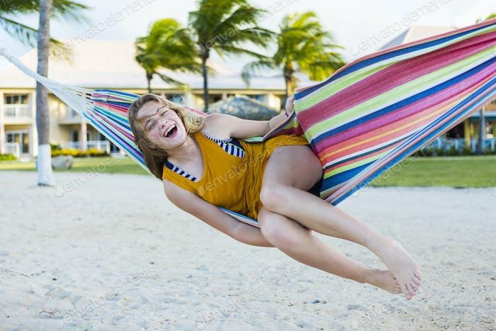 13 year old girl resting in hammock