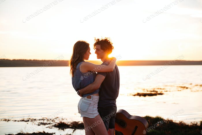 Portrait of a happy young couple hugging at the seaside