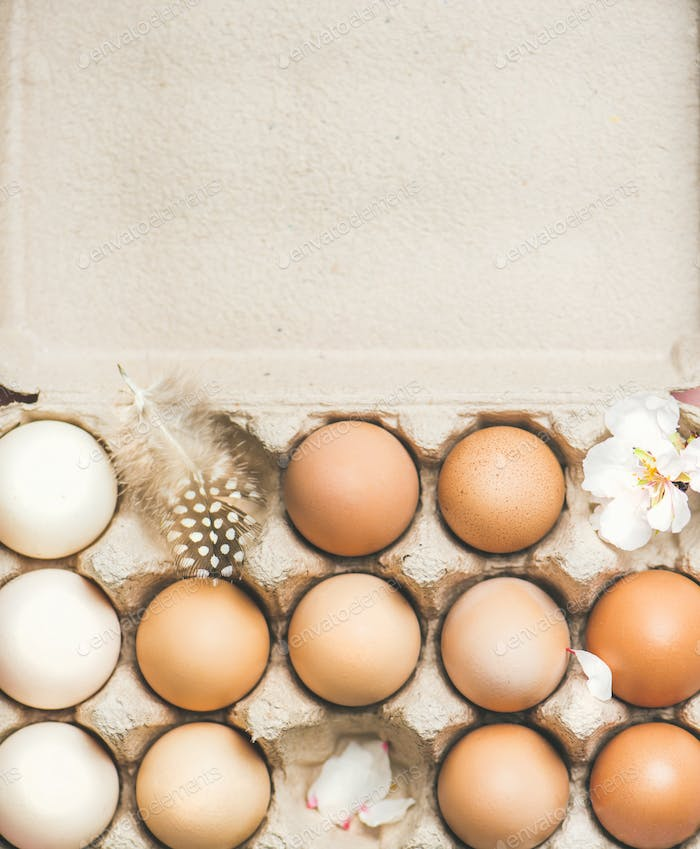 Natural colored eggs in box for Easter,vertical composition