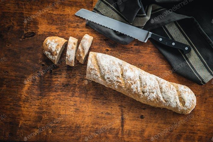 Fresh whole grain bread baguette.