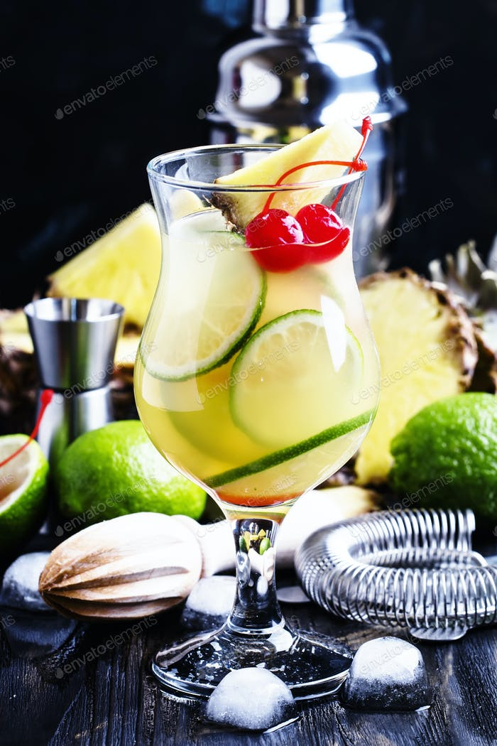 Summer cocktail with pineapple, lime and brandy