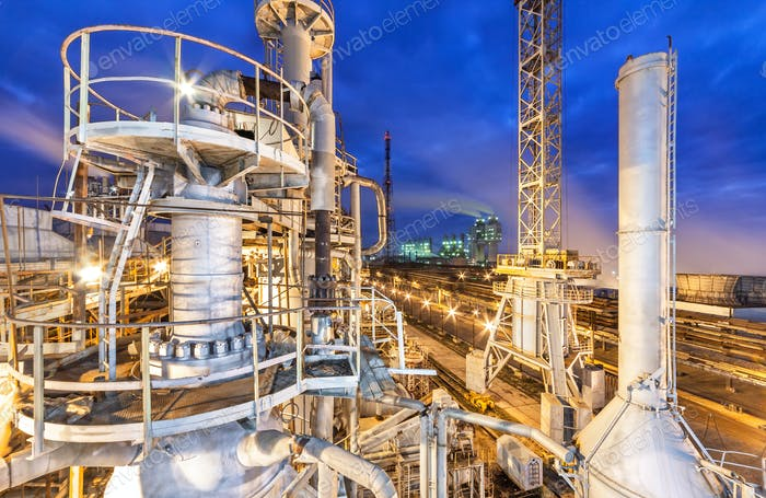 Pipe chemical plant at night