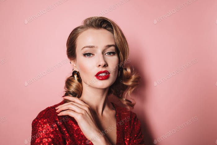 Close up young gorgeous lady with wavy hairstyle and red lips in