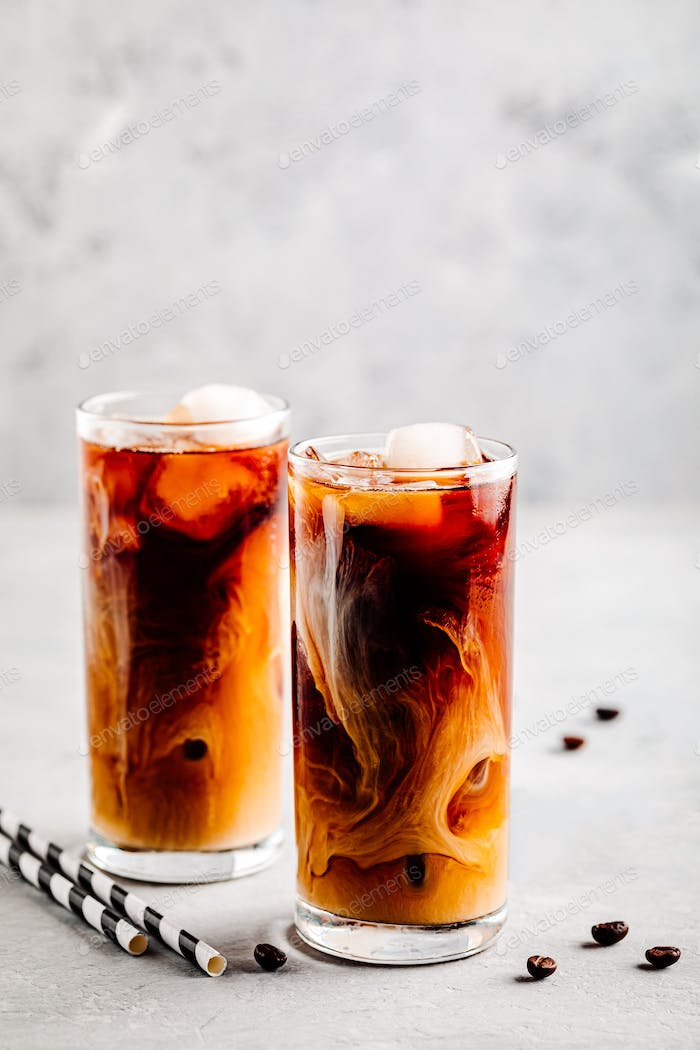 Caramel vanilla iced coffee with ice cubes in tall glasses