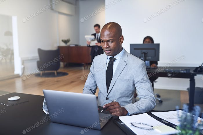 African American businessman working online in a modern office