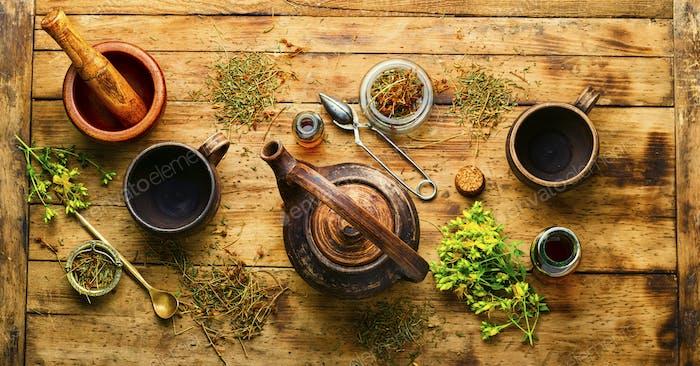 Hypericum in herbal medicine,wooden table