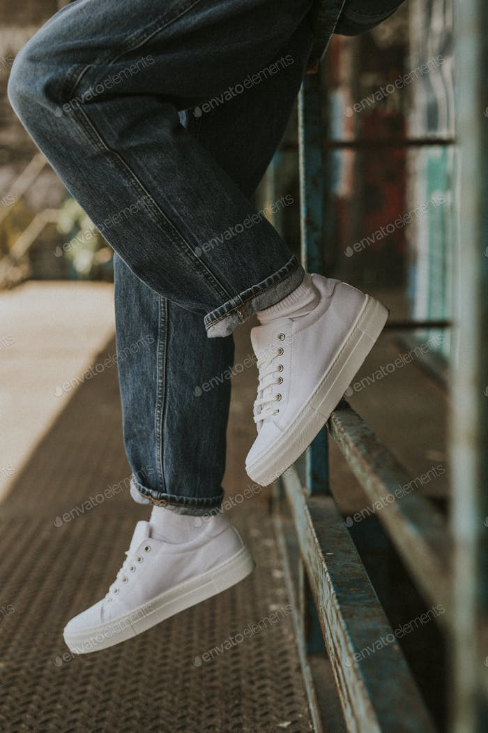 White sneakers on woman model