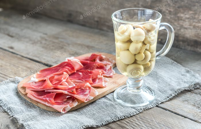 Slices of jamon on the wooden board