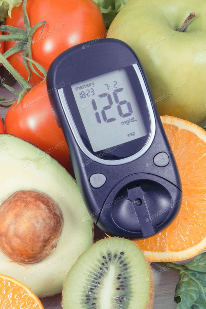 Glucose meter with fresh fruits and vegetables. Healthy nutrition and checking sugar level concept