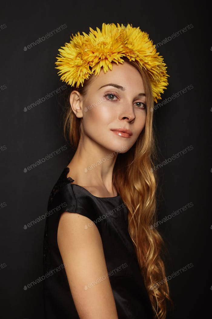 Attractive girl with a wreath on her head