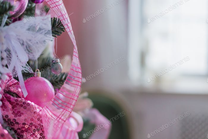 christmas tree decorations in a pink colors