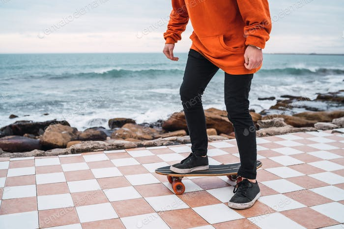 Man practising on the skateboard.