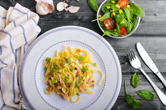 Italian pasta with spring onion and bacon