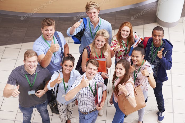 Overhead Portrait Of College Students Standing In Hallway