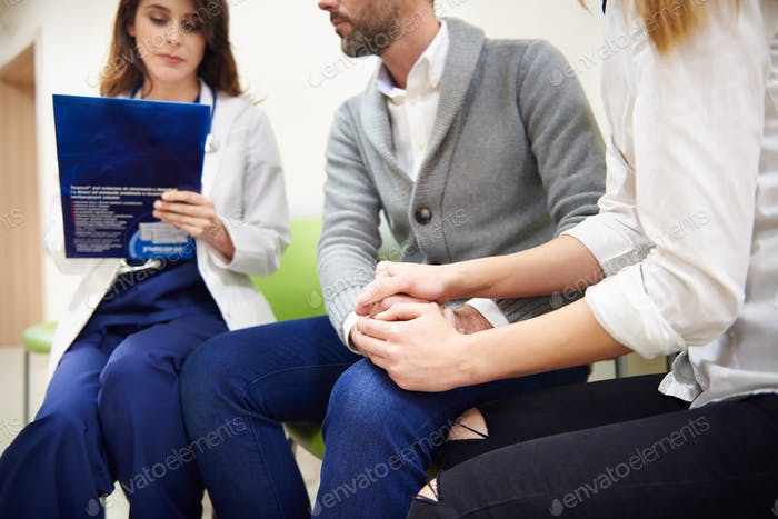 Doctor passing patients a message
