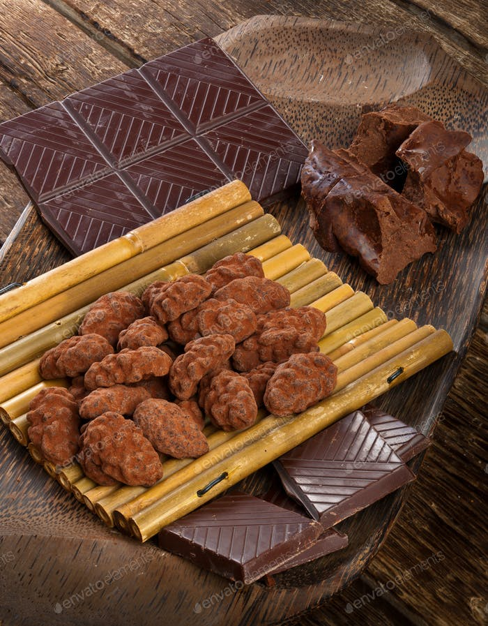 Cocoa beans, dark chocolate and chocolate truffles