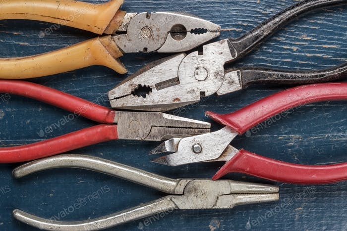 Pliers On Blue Table