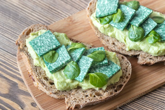 Slices of toasted bread with avocado