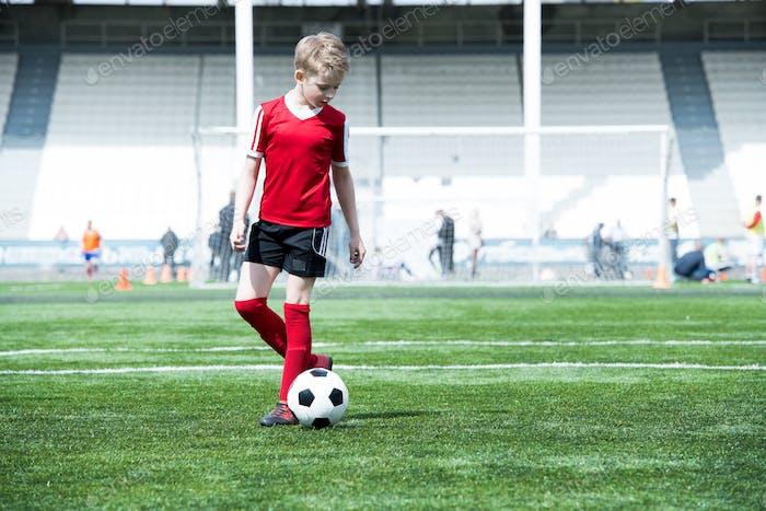 Teenage Boy in Football Field