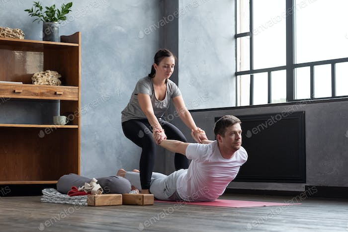 Man practice with private teacher at home class, working out with instructor.