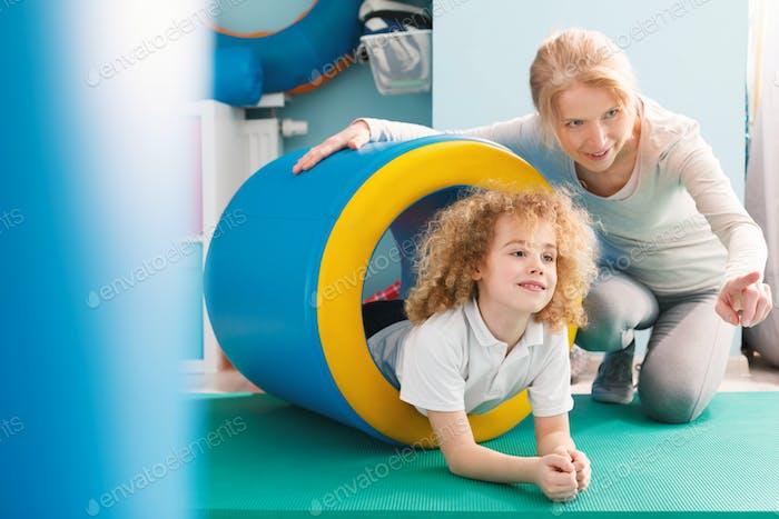 Therapist explaining exercise to a boy