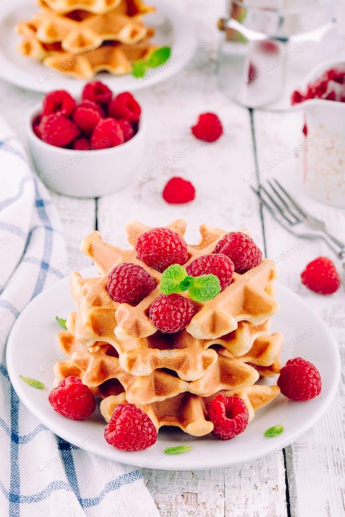 Homemade waffles with fresh raspberries for breakfast