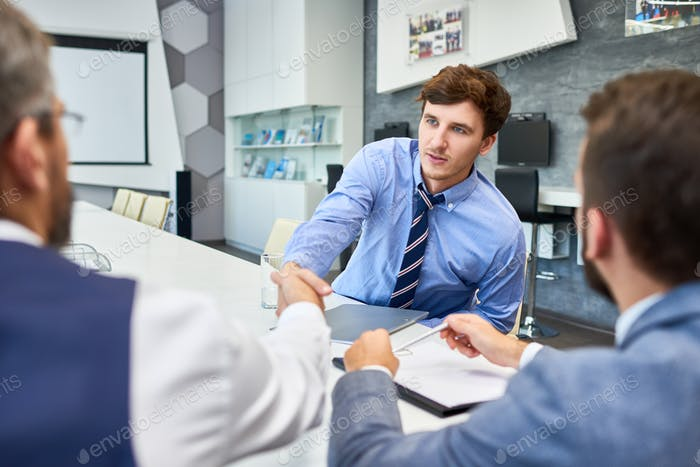 Young Businessman in Negotiation Meeting