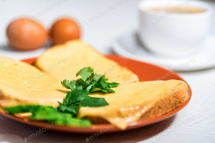 Breakfast of cheese sandwich, eggs and coffee