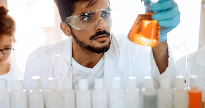 Male student of chemistry working in laboratory