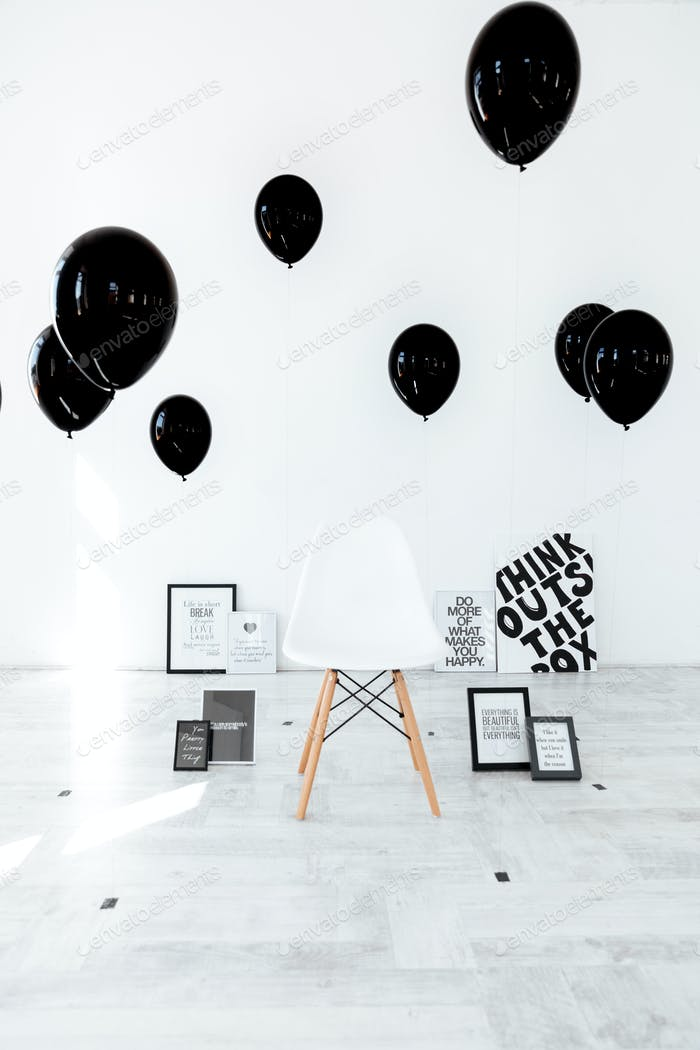 Chair, black posters and air balloons
