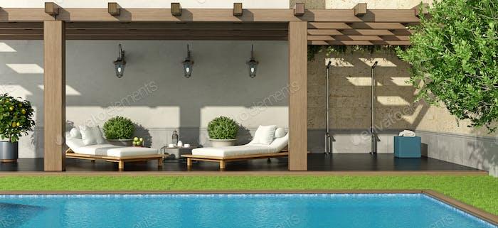 Jardín con pérgola y piscina