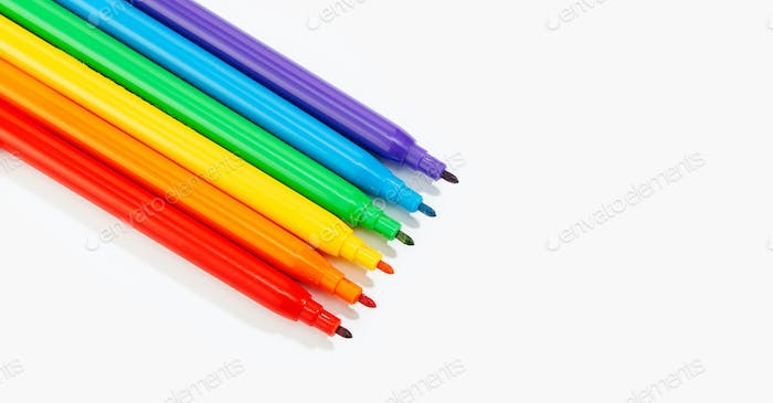 Banner of colored markers isolated on white background