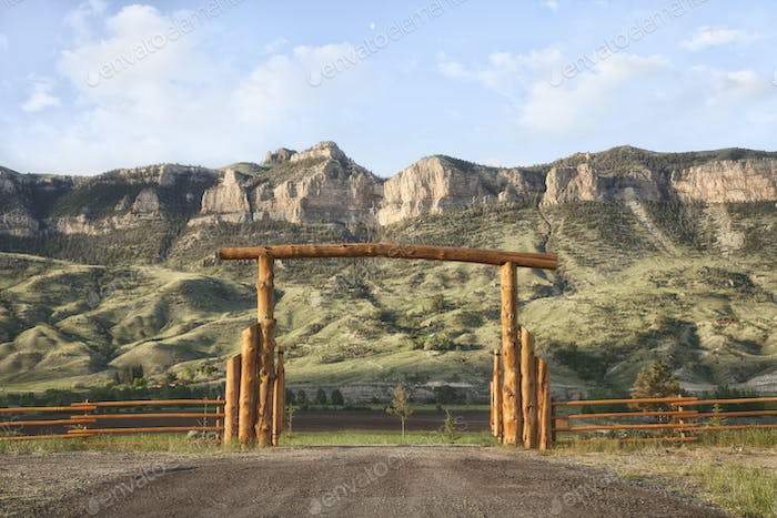 Ranch Gate Below Cliffs in the American West