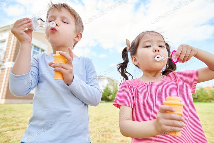 Happy Children Blowing Bubbles
