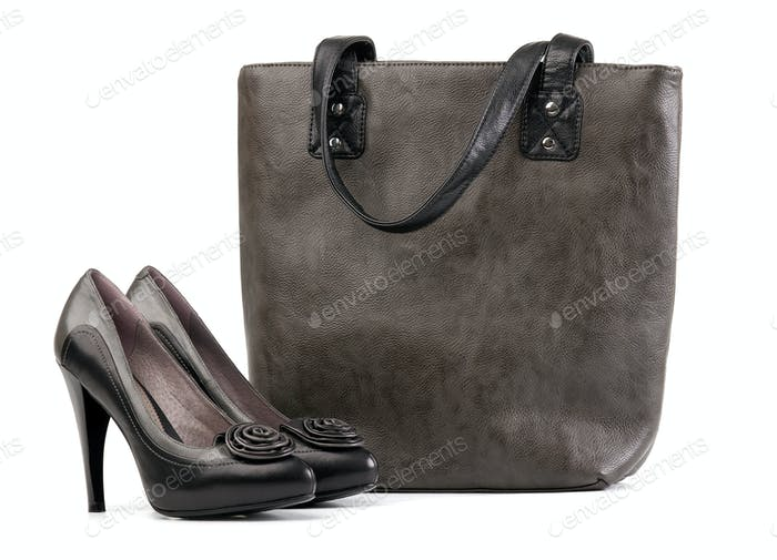Pair of black female shoes and handbag
