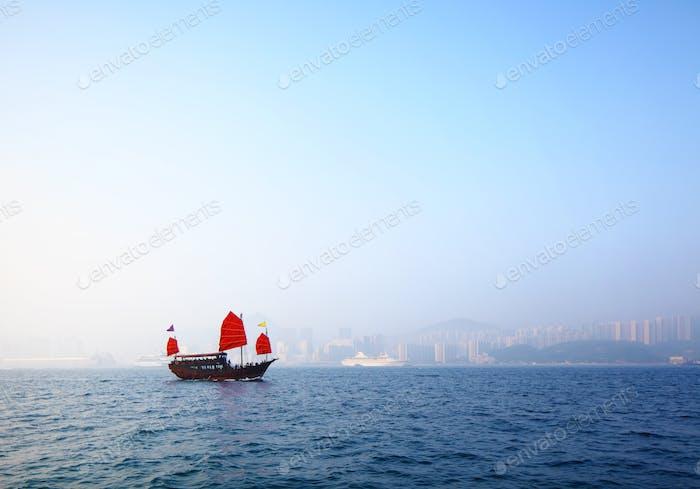 Sailboat sailing in victoria harbor at Hong Kong