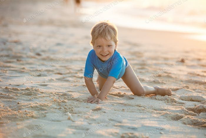 Little boy having fun on the beach