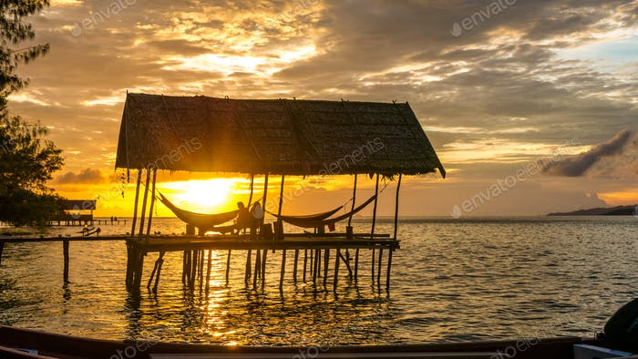 Hammock on Sunset at the Diving Station - Kri Island. Raja Ampat, Indonesia, West Papua