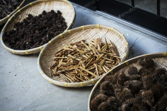 High angle close up of Yashabuji, Haze and Kuri / Chestnut in a textile plant dye workshop.