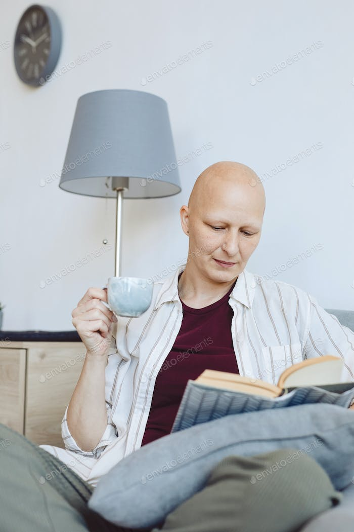 Bald Woman Reading at Home