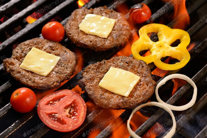 Thumbnail for Grilled meat/burger with cheese on top and vegetable on the flaming grill